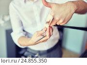 Купить «male stylist hands cutting hair tips at salon», фото № 24855350, снято 15 февраля 2015 г. (c) Syda Productions / Фотобанк Лори