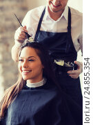 Купить «happy woman with stylist coloring hair at salon», фото № 24855354, снято 15 февраля 2015 г. (c) Syda Productions / Фотобанк Лори