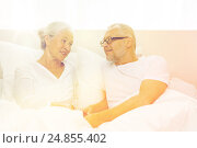 Купить «happy senior coupler lying in bad at home», фото № 24855402, снято 4 сентября 2014 г. (c) Syda Productions / Фотобанк Лори