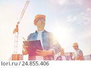 Купить «builder in hardhat with clipboard at construction», фото № 24855406, снято 21 сентября 2014 г. (c) Syda Productions / Фотобанк Лори