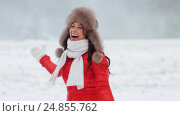 Купить «happy woman having fun outdoors in winter», видеоролик № 24855762, снято 12 января 2017 г. (c) Syda Productions / Фотобанк Лори