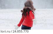 Купить «happy woman having fun outdoors in winter», видеоролик № 24855770, снято 12 января 2017 г. (c) Syda Productions / Фотобанк Лори