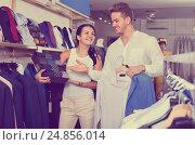 Купить «Couple purchasing shirt, tie and jacket at boutique», фото № 24856014, снято 24 октября 2016 г. (c) Яков Филимонов / Фотобанк Лори