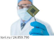 Купить «Doctor holding electronic chip with forceps», фото № 24859790, снято 18 августа 2016 г. (c) Wavebreak Media / Фотобанк Лори
