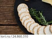 Купить «Nacho chips and rosemary herbs on plate», фото № 24860310, снято 16 сентября 2016 г. (c) Wavebreak Media / Фотобанк Лори
