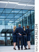 Купить «Businesspeople forming a huddle in office premises», фото № 24862294, снято 6 июля 2016 г. (c) Wavebreak Media / Фотобанк Лори