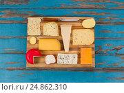 Купить «Cheese with knife on chopping board», фото № 24862310, снято 16 сентября 2016 г. (c) Wavebreak Media / Фотобанк Лори