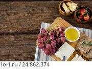 Купить «Gouda cheese, brown bread slices, lime juice and fruits», фото № 24862374, снято 16 сентября 2016 г. (c) Wavebreak Media / Фотобанк Лори