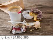 Купить «Leftover doughnut and macaroon with coffee», фото № 24863386, снято 15 сентября 2016 г. (c) Wavebreak Media / Фотобанк Лори