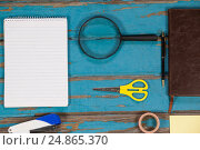 Купить «Notepad, magnifying glass, scissor, stapler, pen sellotape and diary», фото № 24865370, снято 16 сентября 2016 г. (c) Wavebreak Media / Фотобанк Лори