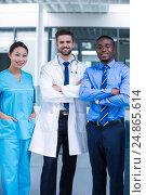 Купить «Nurse and doctor with businessman standing in hospital», фото № 24865614, снято 6 июля 2016 г. (c) Wavebreak Media / Фотобанк Лори