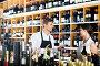 Seller in a wine house and visitor, фото № 24866138, снято 15 января 2017 г. (c) Яков Филимонов / Фотобанк Лори