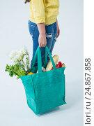 Купить «Woman carrying grocery bag», фото № 24867858, снято 15 сентября 2016 г. (c) Wavebreak Media / Фотобанк Лори