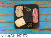 Купить «Brown bread, dutch gouda cheese, rosemary and ham on slate board», фото № 24867970, снято 16 сентября 2016 г. (c) Wavebreak Media / Фотобанк Лори
