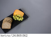 Купить «Gouda cheese, grapes and brown bread slices on slate plate», фото № 24869062, снято 16 сентября 2016 г. (c) Wavebreak Media / Фотобанк Лори
