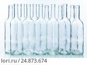 Купить «Dozen empty bottles arranged chess-board fashion», фото № 24873674, снято 5 января 2016 г. (c) Сергей Новиков / Фотобанк Лори
