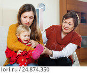 Купить «Young mother with crying baby and grandmother after quarrel», фото № 24874350, снято 9 декабря 2017 г. (c) Яков Филимонов / Фотобанк Лори