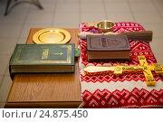 Купить «The Bible and the cross. Preparing for the rite of infant baptism.», фото № 24875450, снято 28 мая 2016 г. (c) Анастасия Улитко / Фотобанк Лори