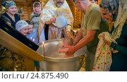 Купить «Обряд крещения ребенка в православной церкви», фото № 24875490, снято 28 мая 2016 г. (c) Анастасия Улитко / Фотобанк Лори