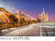 Купить «Holiday New Year's Red Square and St. Basil's Cathedral in the morning light of lanterns and snow. On signs it is written: Marketplace on the Red Square.», фото № 24876382, снято 4 декабря 2016 г. (c) Baturina Yuliya / Фотобанк Лори
