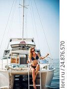 Купить «Beautiful woman sits on white yacht in the sea», фото № 24876570, снято 1 августа 2016 г. (c) katalinks / Фотобанк Лори