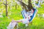 Beautiful pregnant woman in hammock in blooming garden, фото № 24882266, снято 19 апреля 2016 г. (c) Дарья Петренко / Фотобанк Лори