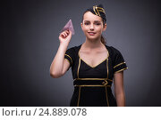 Купить «Young flight attendant on gray background», фото № 24889078, снято 4 августа 2016 г. (c) Elnur / Фотобанк Лори