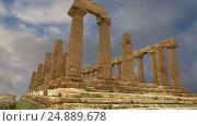 Купить «Ancient Greek Temple of Juno (V-VI century BC), Valley of the Temples, Agrigento, Sicily. The area was included in the UNESCO Heritage Site list in 1997», видеоролик № 24889678, снято 17 января 2017 г. (c) Владимир Журавлев / Фотобанк Лори