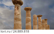 Купить «Remains of an ancient Greek temple of Heracles (V-VI century BC), Valley of the Temples, Agrigento, Sicily. The area was included in the UNESCO Heritage Site list in 1997», видеоролик № 24889818, снято 18 января 2017 г. (c) Владимир Журавлев / Фотобанк Лори