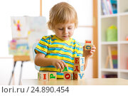 kid boy playing with block toys and learning letters. Стоковое фото, фотограф Оксана Кузьмина / Фотобанк Лори