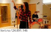 Купить «Woman singing in recording studio», видеоролик № 24891146, снято 8 июля 2020 г. (c) Wavebreak Media / Фотобанк Лори