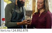 Купить «Workers discussing over smartphone», видеоролик № 24892878, снято 22 июля 2018 г. (c) Wavebreak Media / Фотобанк Лори
