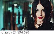 Купить «Portrait of a dark-haired girl with red lips and a gun in the hands of», видеоролик № 24894690, снято 17 января 2017 г. (c) Сергей Мнацаканов / Фотобанк Лори