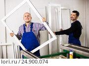 Купить «Workmen inspecting PVC manufacturing output», фото № 24900074, снято 14 июля 2020 г. (c) Яков Филимонов / Фотобанк Лори