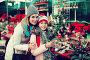 Happy mom and girl looking at flowers decoration, фото № 24900254, снято 20 января 2017 г. (c) Яков Филимонов / Фотобанк Лори