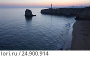 Купить «Sea coast sunset landscape and lighthouse», видеоролик № 24900914, снято 14 января 2017 г. (c) Юрий Брыкайло / Фотобанк Лори