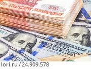 Купить «Пачка пятитысячных купюр российских рублей лежит на американских долларах», фото № 24909578, снято 2 июля 2020 г. (c) FotograFF / Фотобанк Лори