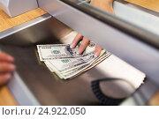 Купить «clerk giving cash money to customer at bank office», фото № 24922050, снято 8 сентября 2016 г. (c) Syda Productions / Фотобанк Лори