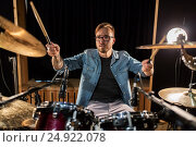 Купить «male musician playing drums and cymbals at concert», фото № 24922078, снято 18 августа 2016 г. (c) Syda Productions / Фотобанк Лори