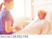 Купить «doctor or nurse visiting senior woman at hospital», фото № 24922154, снято 11 июня 2015 г. (c) Syda Productions / Фотобанк Лори