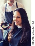 Купить «happy young woman coloring hair at salon», фото № 24922182, снято 15 февраля 2015 г. (c) Syda Productions / Фотобанк Лори