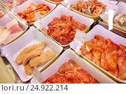 Купить «marinated meat in bowls at grocery stall», фото № 24922214, снято 2 ноября 2016 г. (c) Syda Productions / Фотобанк Лори