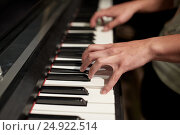 Купить «close up of hands playing piano», фото № 24922514, снято 18 августа 2016 г. (c) Syda Productions / Фотобанк Лори