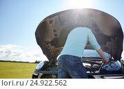 Купить «man with open hood of broken car at countryside», фото № 24922562, снято 12 июня 2016 г. (c) Syda Productions / Фотобанк Лори