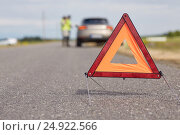 Купить «warning triangle over broken car on road», фото № 24922566, снято 12 июня 2016 г. (c) Syda Productions / Фотобанк Лори