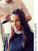 Купить «happy woman with stylist making hairdo at salon», фото № 24922670, снято 15 февраля 2015 г. (c) Syda Productions / Фотобанк Лори