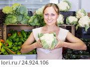 Купить «young woman shopping fresh cabbage», фото № 24924106, снято 23 ноября 2019 г. (c) Яков Филимонов / Фотобанк Лори