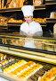 staff offering fresh baguettes, фото № 24930454, снято 4 октября 2016 г. (c) Яков Филимонов / Фотобанк Лори