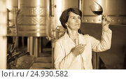 Купить «worker costs with wineglass», фото № 24930582, снято 12 октября 2016 г. (c) Яков Филимонов / Фотобанк Лори
