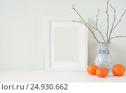 Купить «Minimal elegant composition with tangerines and vase», фото № 24930662, снято 15 октября 2018 г. (c) Екатерина Рыбина / Фотобанк Лори